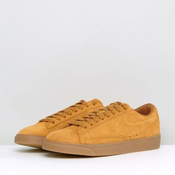 Nike Blazer Low Trainers In Gold Suede With Gum Sole at asos.com
