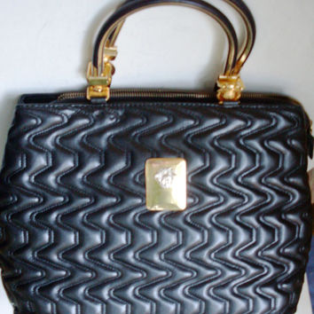 black leather bag, handbag Gianni Versace, vintage bag, made in Italy in 1980, completed with trademarks in brass, brand Versace, rarity