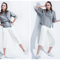wide leg pants in white,crop length,side pocket,casual,elegant,unique,high fashion,mod,chic,for summer.--E0261