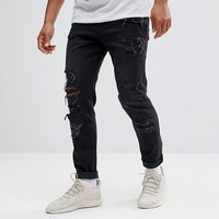 ASOS Tapered Jeans In 12.5oz In Washed Black With Heavy Rips at asos.com