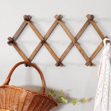 Exceptional Rustic Accordion Peg Rack Photo