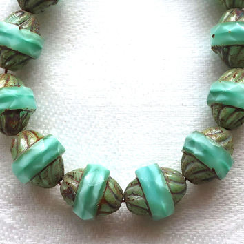 Five Czech glass faceted turbine beads, 11 x 10mm milky & translucent mint green satin mix with a picasso finish C01101