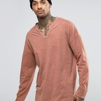 ASOS Oversized Longline Long Sleeve T-Shirt In Textured Fabric With Grandad Collar at asos.com