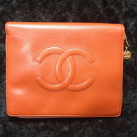 MINT. 90's Vintage CHANEL caviarskin travel and cosmetic case pouch, mini bag in orange, rare piece. Best vintage Chanel for the season