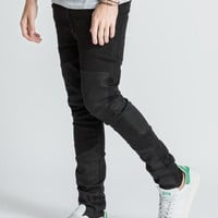 Cheap Monday Tight Skinny Fit Coated Cut Panelled Jeans | HYPEBEAST Store.