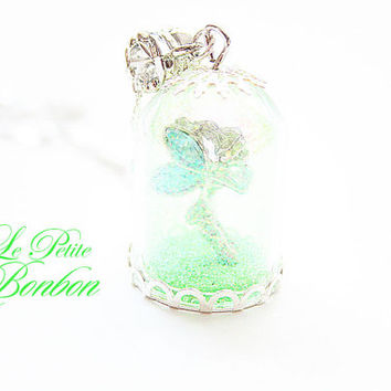 Tinkerbell with pixie dust in a glass capsule necklace