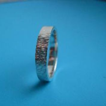 Supermarket - Silver cog hammered wedding band from Nina Dinoff Jewelry