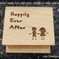 Music box engraved with Happily Ever After and a boy and girl image engraved to the top, choose your song and color