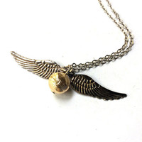 flying golden sphere necklace, winged gold orb charm