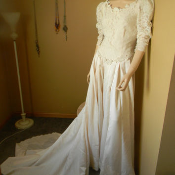1950S Baroque IVORY SILK wedding Gown. Pearl Mushroom Button back up closure and wrists.Long Train that hooks up into a short poof Bustle ~