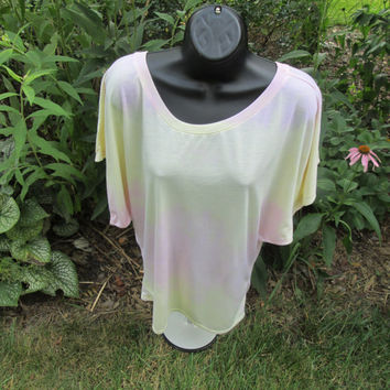 Ladies or teens tie-dye Large shirt,  65 percent polyester, 35 percent viscose, coral and yellow, fluttery sleeves, machine wash, dry.