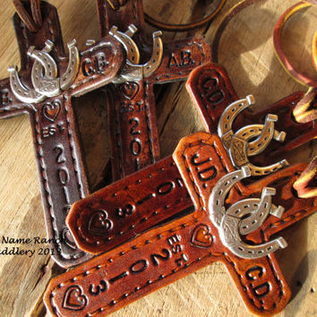 Custom-made His & Hers saddle crosses with double horse shoe concho