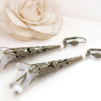 Art deco bronze bridal earrings with filigree and white flower trumpets