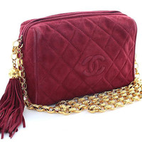 Vintage CHANEL rare color in wine red, burgundy genuine suede camera bag style shoulder purse with gold tone chain strap and tassel. CC