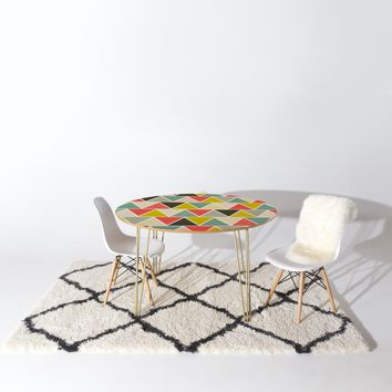 Heather Dutton Triangulum Round Table