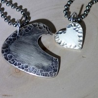 Couples necklace with guitar pick and interlocking heart