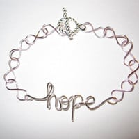 Silver Hope Light Pink Infinity Bracelet by aLilJazzJewelry