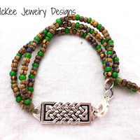 Sterling silver Celtic bar and seed bead multi strand bracelet.