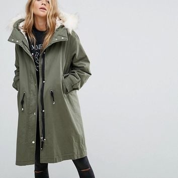 Pull&Bear Longline Parka Jacket With Faux Fur Hood at asos.com