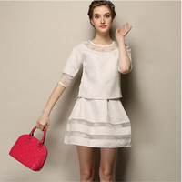 White Cutout Mesh Sleeve Blouse With Paired Pleated Skirt