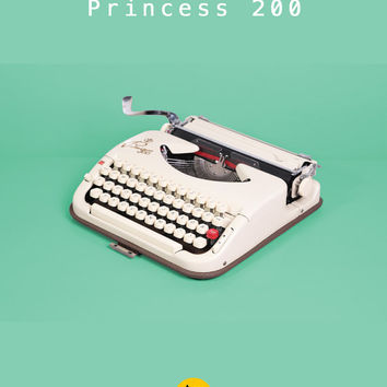 1957 Princess 200 Typewriter. Fully working condition. German portable. Ivory color. With light brown case.
