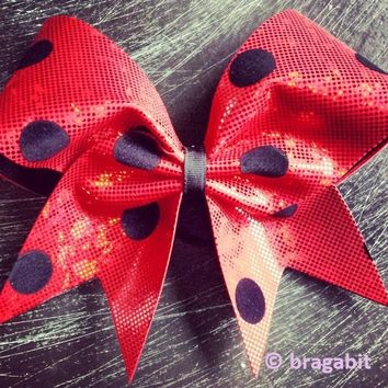 Red cheer bow with black dots.