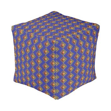 Geometric Blue Pattern and Golden Pouf