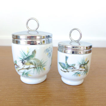Pair of Royal Worcester porcelain egg coddlers, Birds pattern
