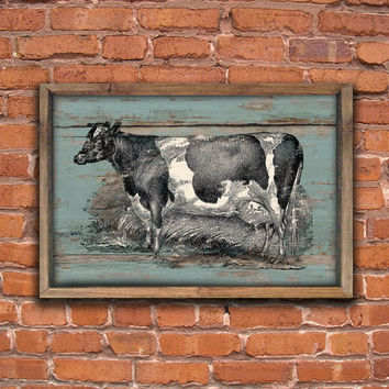 Wooden vintage style cow sign framed out in reclaimed wood.  Approx. 19.5x14x2 inches.