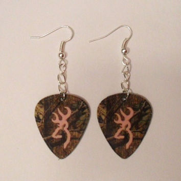 Mossy Oak Camo with light pink browning deer symbol guitar pick earrings