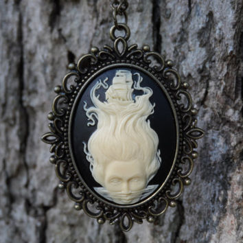 Siren of the Sea mermaid with Pirate ship cameo necklace.