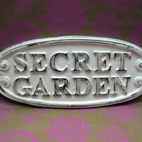 Secret Garden Wall Plaque Sign Cast Iron Distressed Shabby Chic Off White Metal Oval Oblong Ornate Scroll Accented Wall Door Sign