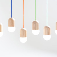 Light Bean is a lamp fixture made of Russian oak. Globe bulb is not only the source of light but also an integral part of the shape.