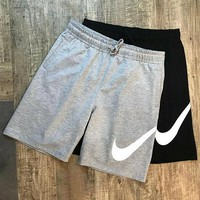 Nike big logo print cotton knit loop casual sport shorts running workout five-minute pants