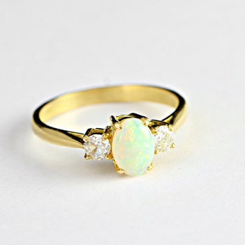 Opal and Diamond engagement ring in 18 carat gold