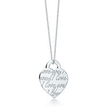 """Tiffany & Co. -  Tiffany Notes """"I Love You"""" heart pendant in sterling silver."""