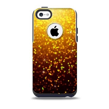 The Bright Gold Glowing Sparks Skin for the iPhone 5c OtterBox Commuter Case