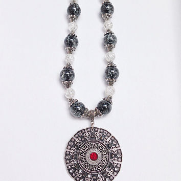 Bullet jewelry. Beaded necklace with bullet casing
