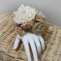 Rustic Wrist Corsage handmade of sola flower, burlap, antique brown paper mini roses, dried mini roses and satin ribbon. Made to Order.