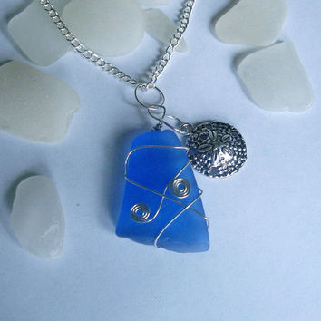 Large blue beach sea glass necklace with sand dollar. Beach glass jewelry.