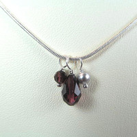 Necklace crystals burgundy and one faux grey pearl, small and delicate