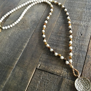 Change and Prosperity, Riverstone and Tigers Eye Mala Necklace with Tibetan Calendar Pendant