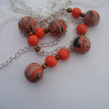 Coral necklace ,  Springtime necklace , Coral  beads , four strands of 2 beads , 1 strand of 3 beads , 5 large marbled beads , 6 plain beads