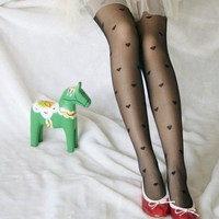 Heart Printed Tights from Poison