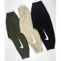 NIKE New fashion hook print sports leisure couple pants