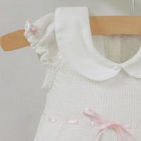 White knit baby dress with pink flowers
