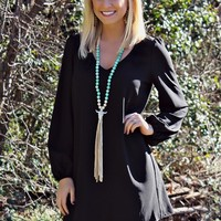 Long Sleeve dress with scoop neck and elastic in the sleeve.
