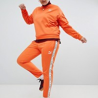 Puma Exclusive To ASOS Plus Taped Side Stripe Track Pants In Orange at asos.com