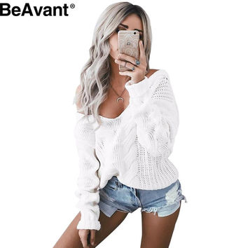 BeAvant Winter knitted sweater women 2016 Autumn white hollow out pullover sweater Sexy deep v neck long sleeve jumpers