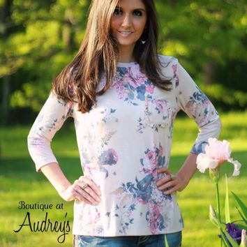 Cherish Floral Print Top with Three Quarter Sleeves and Ruffled Front Pocket
